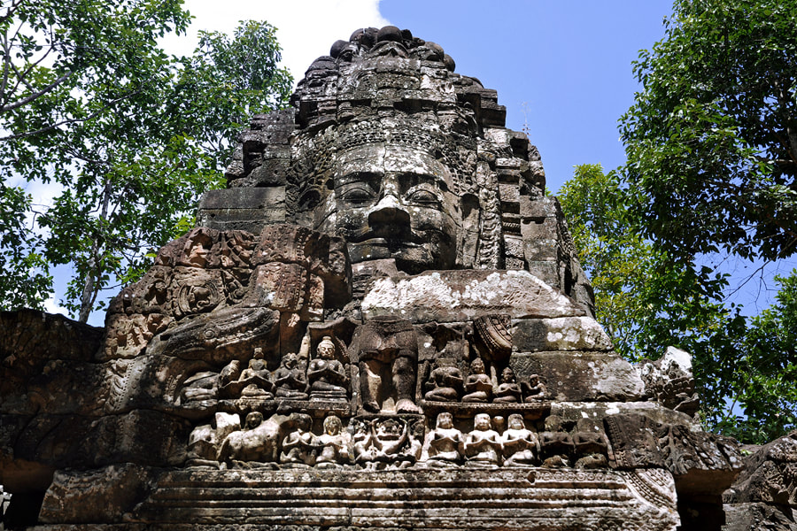 pediment with damaged Lokeshvara figure at Ta Som's western face tower